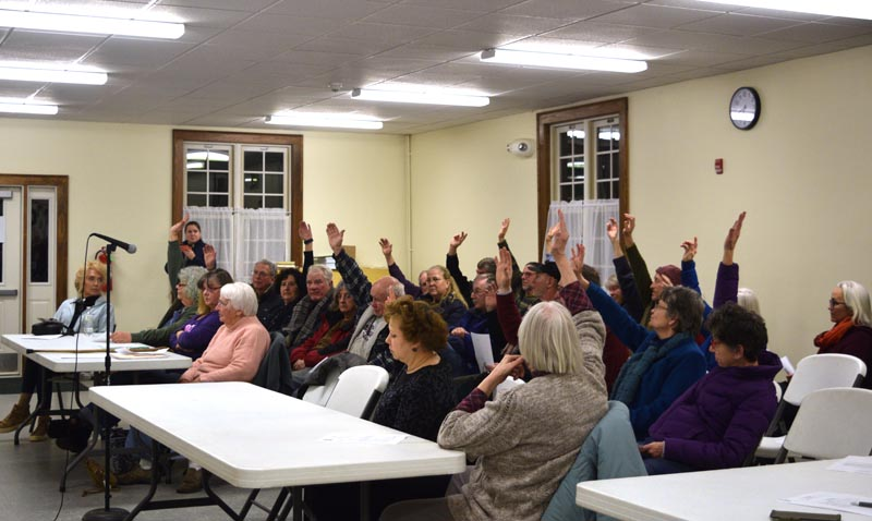 Dresden residents vote to appropriate $50,000 from surplus to buy 540 Gardiner Road during a special town meeting at Pownalborough Hall on Wednesday, Jan. 15. (Jessica Clifford photo)