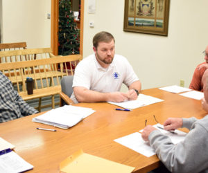 From left: Alden McFarland, South Bristol's representative to the Central Lincoln County Ambulance Service Inc. Board of Trustees, and Nick Bryant, service chief, meet with the South Bristol Board of Selectmen on Thursday, Dec. 19. (Evan Houk photo)