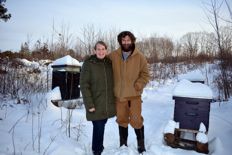 Maisie and Matthew Sturtevant, of Switchback Farm, near their beehives. The farm harvested 500 pounds of honey last year and plans to double its output in 2020, according to Matthew Sturtevant. (Alexander Violo photo)