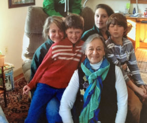 Millie Sabatine relaxes with her five grandchildren: Kaleb Bridgham (back) and (from left) Kelsea Bridgham, Henry Sabatine, Kate Bridgham, and Sam Sabatine. (Photo courtesy Lisa Sabatine)