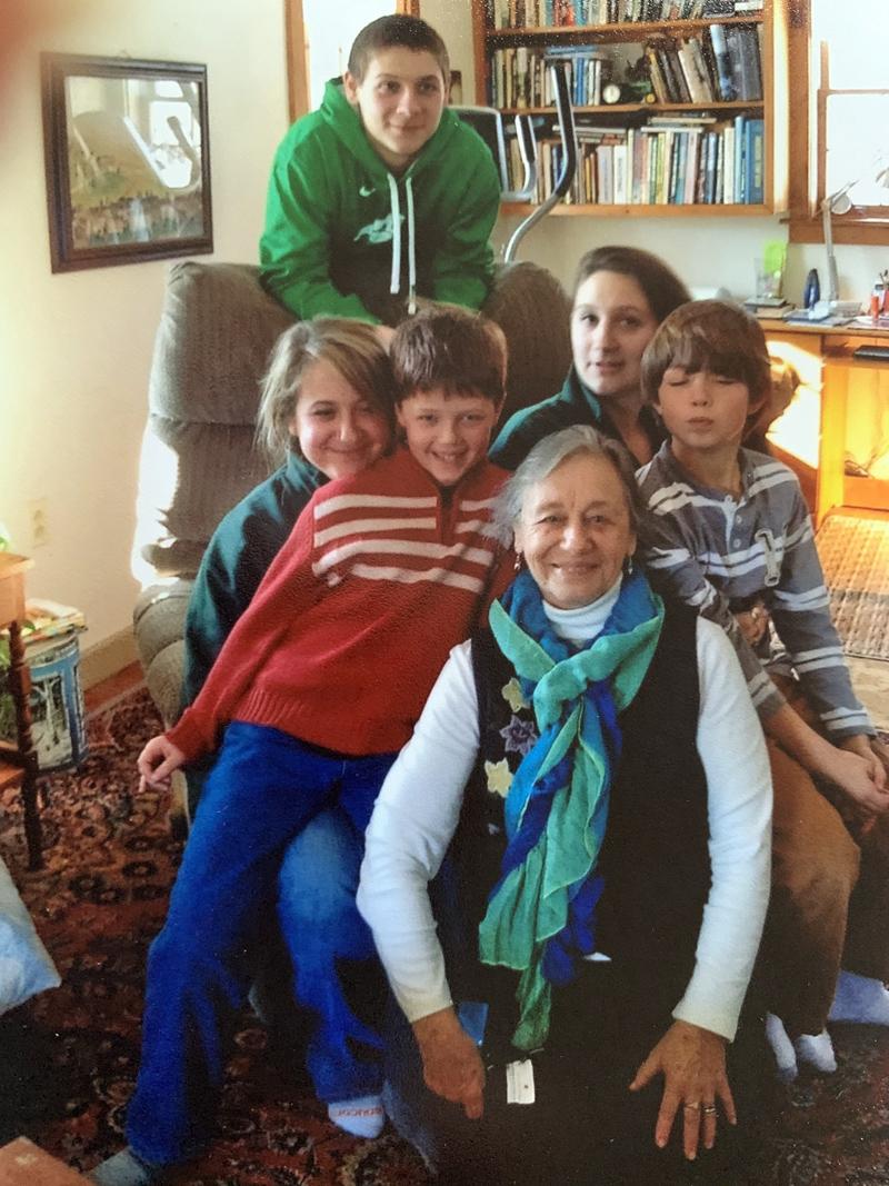 Millie Sabatine relaxes with her five grandchildren: Kaleb Bridgham (back) and (from left) Kelsea Bridgham, Henry Sabatine, Kate Bridgham, and Sam Sabatine. (Photo courtesy Lisa Sabatine)