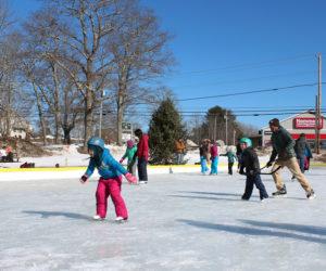 Skaters enjoy Coastal Rivers Conservation Trust's community skating rink at Round Top Farm.