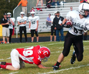 Mason St. Louis escapes a tackle in Lincoln County Football action at Cony in 2014. The nonprofit Lincoln County Football program will cease operations afer 19 years. (LCN file photo)