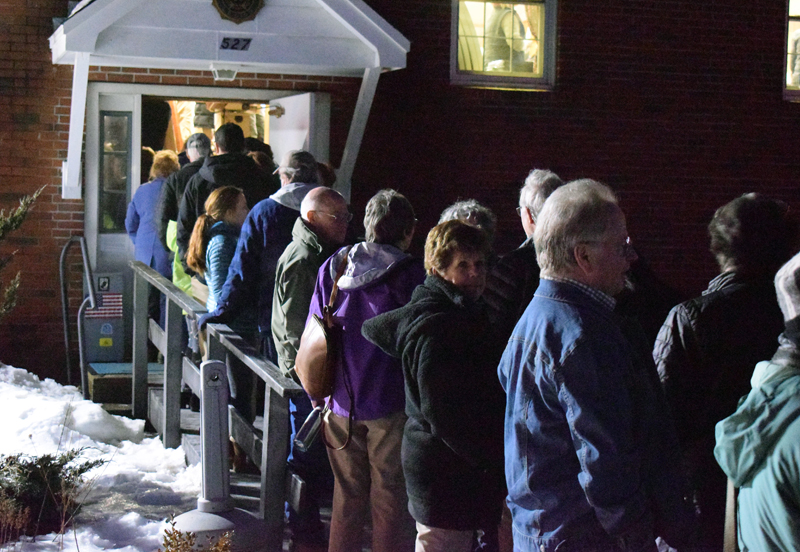 People wait outside the Wells-Hussey American Legion Post in Damariscotta to enter for an event with Sara Gideon, Democratic candidate for U.S. Senate. (Evan Houk photo)
