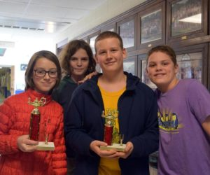 From left: Great Salt Bay Community School seventh graders Eli Melanson, Gavin Parson, Joseph Levesque, and Jayden Brown display their trophies from competition in the Central Maine Math League this year. (Jessica Clifford photo)