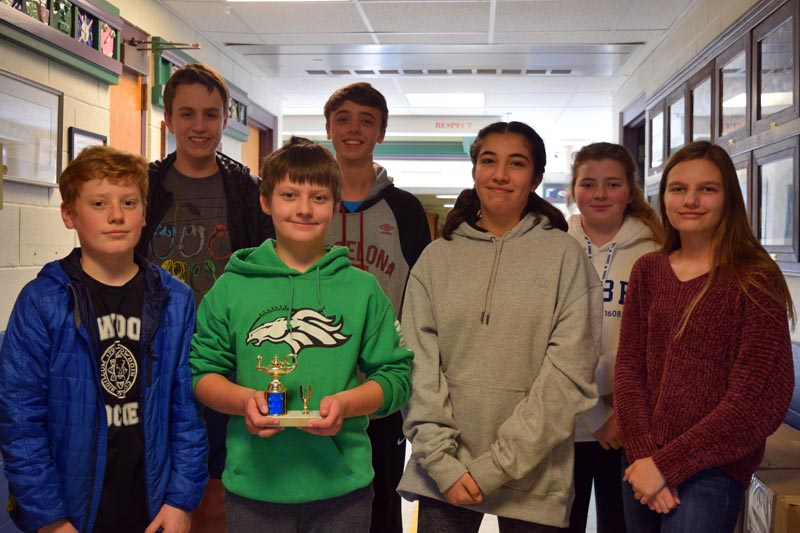 Members of Great Salt Bay Community School's eighth grade math teams display a trophy from a recent meet. Front from left: Mica Houghton, Jacob Caron, Halena Stone, and Kayla Cruz. Back from left: Connor Parson, Conor Cass, and Elizabeth Rethman. (Jessica Clifford photo)