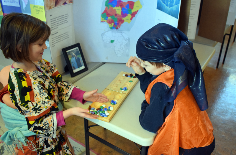 Seven-year-old homeschoolers Agnes Eddyblouin and Oliver Goding play the traditional Nigerian board game ayo during Homeschooler Cultural Day at Skidompha Library in Damariscotta on Thursday, Jan. 30. (Evan Houk photo)