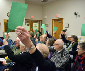 Damariscotta voters approve the creation of a tax increment financing district during a special town meeting at the town office Wednesday, Feb. 19. TIF district revenue will fund sidewalk construction on Main Street. (Evan Houk photo)