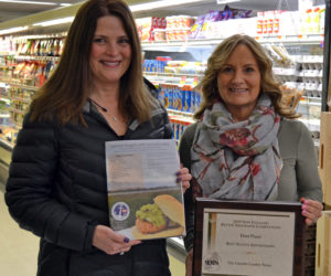 From left: Julie Greenleaf, advertising representative for The Lincoln County News, holds an award-winning advertisement for Main Street Grocery while Main Street Grocery owner Jane Gravel holds the award. The LCN won first place for native advertising in the New England Newspaper and Press Association Better Newspaper Contest. The winning advertisement was a featured recipe page in Lincoln County Magazine.