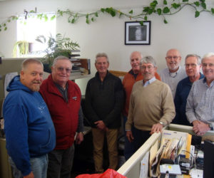 From left: Lincoln County Sheriff Todd Brackett meets with members of a local men's group, Dick Mayer, Rick Hagen, Bruce Lutsk, Ted Silar, Doug Cameron, Bill Coyne, and Wayne Moore. The group bought and donated software and hardware necessary for the RUOK program, which facilitates daily welfare checks on those in need. (Jessica Clifford photo)