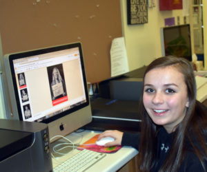 Shyla Waltz, a sophomore at Medomak Valley High School, works on #WhyYouMatter photos on the computer in the school's art room. (Alexander Violo photo)