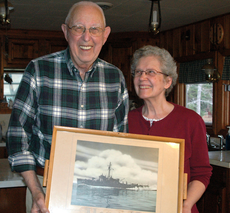 Alvah and Georgetta Moody, in 2013, hold a picture of a ship Alvah Moody served on during World War II. Moody, a co-owner of Moody's Diner who spent virtually his entire career there, died Feb. 8. (LCN file photo)