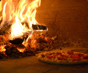 A pepperoni pizza in the wood-fired oven at Odd Alewives Farm Brewery in Waldoboro. (Maia Zewert photo)