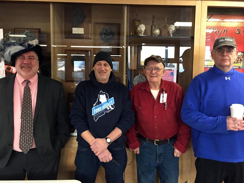 From left: Wiscasset Middle High School Principal Charles Lomonte, science teacher Ralph Keyes, substitute teacher Blinn LeBourdais, and Assistant Principal Warren Cossette wear hats for a cause Jan. 24. (Photo courtesy Deb Pooler)