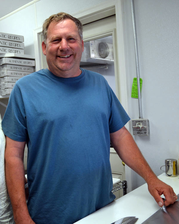 Gregory Lemar, then-owner of the Dresden Take Out, attends the grand reopening of the business in June 2014. Lemar, of Wiscasset, the longtime owner of Greg's Used Cars & Service Inc., died in a snowmobile crash Sunday, Feb. 23. (Charlotte Boynton photo, LCN file)