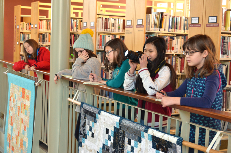 The 2020 Junior Journalists watch the STEAM-uary egg drop. From left: Aja Chung, Lauren Lee, Sofia Michaud, YuJi Smith, and Sarah Vallance. (Maia Zewert photo)