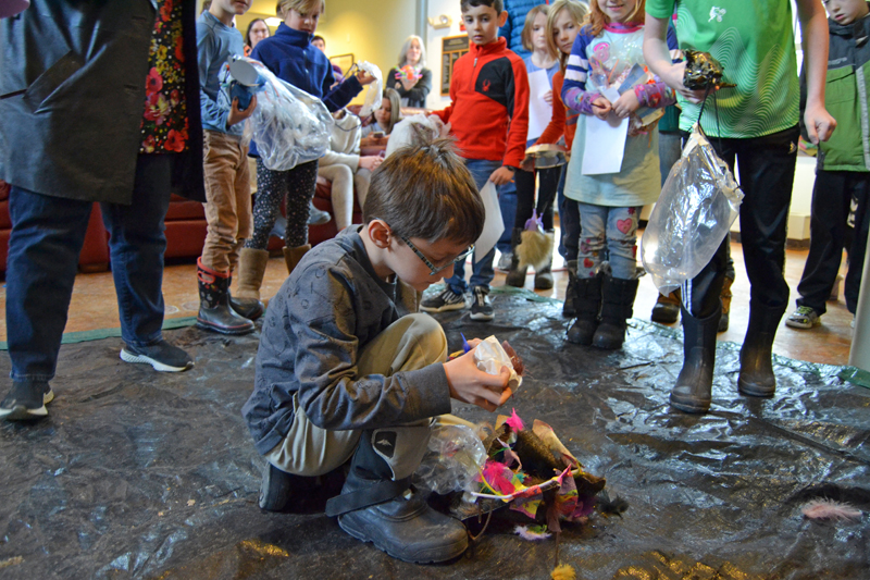 Tristan Greenleaf, 8, of Bristol, checks to see if his egg survived the drop. (Maia Zewert photo)