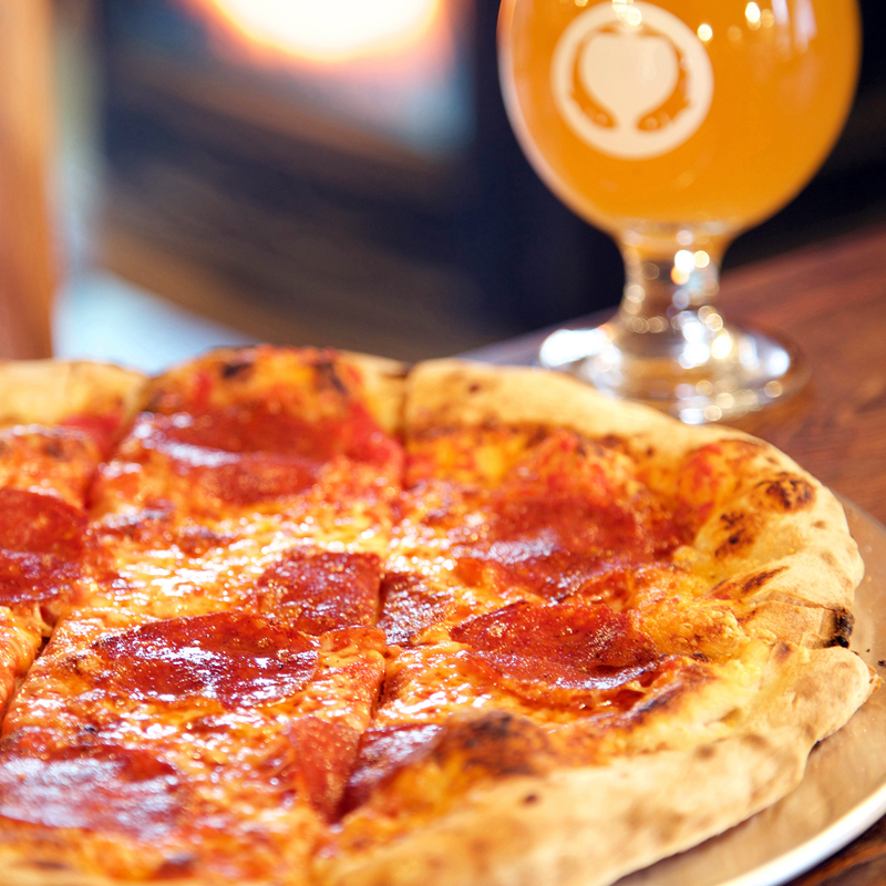 Twelve-inch wood-fired pepperoni pizzas are on the menu at Odd Alewives Farm Brewery.