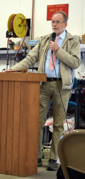 Chris Cooper moderates annual town meeting in Alna on Saturday, March 21. Voters tabled many articles for a later date due to coronavirus concerns. (Jessica Clifford photo)