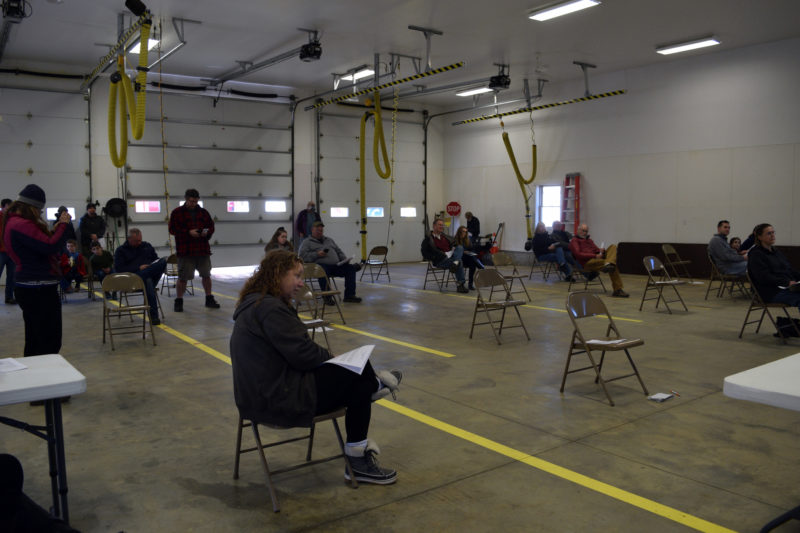 Alna voters practice social distancing during annual town meeting in the truck bay of the fire station Saturday, March 21. Thirty-two people attended. (Jessica Clifford photo)