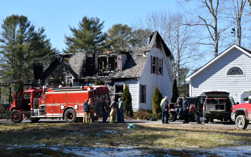 Boothbay firefighters monitor the remains of a house at 30 Sunny Acres Lane after a fire early Thursday, March 5. The fire started shortly after midnight, then rekindled around 6 a.m. (Evan Houk photo)