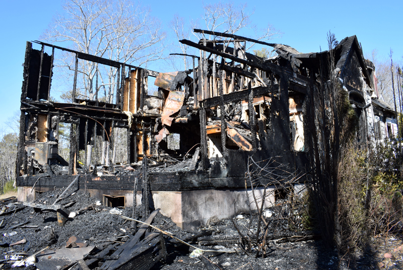 The remains of a house at 30 Sunny Acres Lane in Boothbay after a fire early Thursday, March 5. (Evan Houk photo)
