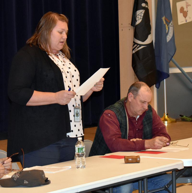 Jefferson Selectman Pamela Grotton moderates a special town meeting at Jefferson Village School on Monday, March 2, as Selectman Gregory Johnston looks on. (Alexander Violo photo)