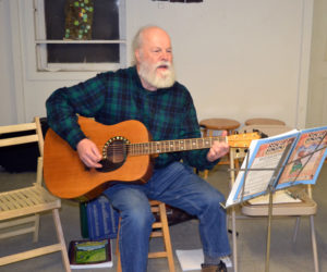 Dan Townsend leads the monthly community singing circle at Sheepscot General in Whitefield on the evening of Saturday, Feb. 29. (Christine LaPado-Breglia photo)