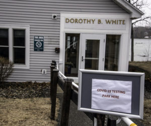 A sign directs people to park in front of the Dorothy B. White building, on LincolnHealth's Miles Campus in Damariscotta, for COVID-19 testing, Tuesday, March 17. The hospital will only test patients on a doctor's orders. (Bisi Cameron photo)