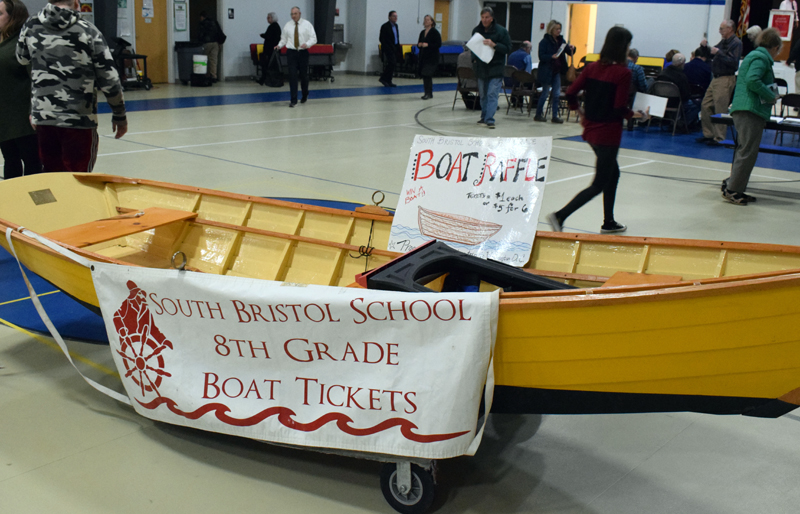 South Bristol School eighth graders raffled off a boat built by the class of 2019 at annual town meeting Tuesday, March 10. David Poland won the boat. (Evan Houk photo)