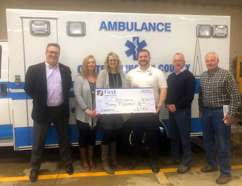 From left: First National Bank Senior Vice President/Senior Regional Business Relationship OfficerTodd Savage, Branch Manager Jessica Day, Vice President/Regional Manager Michelle Curtis, Central Lincoln County Ambulance Service Chief Nicholas Bryant, First National Bank President and CEO Tony McKim, and South Bristol Board representative Alden McFarland.