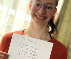 Big Sister Rachael Rademacher shows a recent letter she received from Little Sister Abby. Big Brothers Big Sisters of Mid-Maine has created a pen pal program for matches during this time of social distancing.