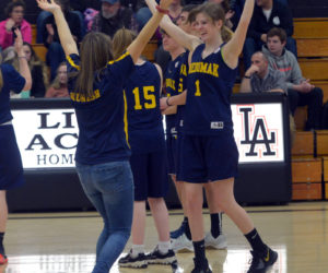 "Medomak Valley Unified coach Emma Kunesh and Michaela Staples dance to ""Y.M.C.A."" at halftime of their game at Lincoln Academy. (Paula Roberts photo)"