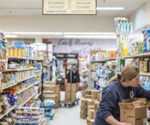 Emily Pierce stocks cleaning supplies at Main Street Grocery in Damariscotta on March 28. IGA recently named Main Street Grocery one of its Five-Star Retailers for 2020. (Bisi Cameron Yee photo, LCN file)
