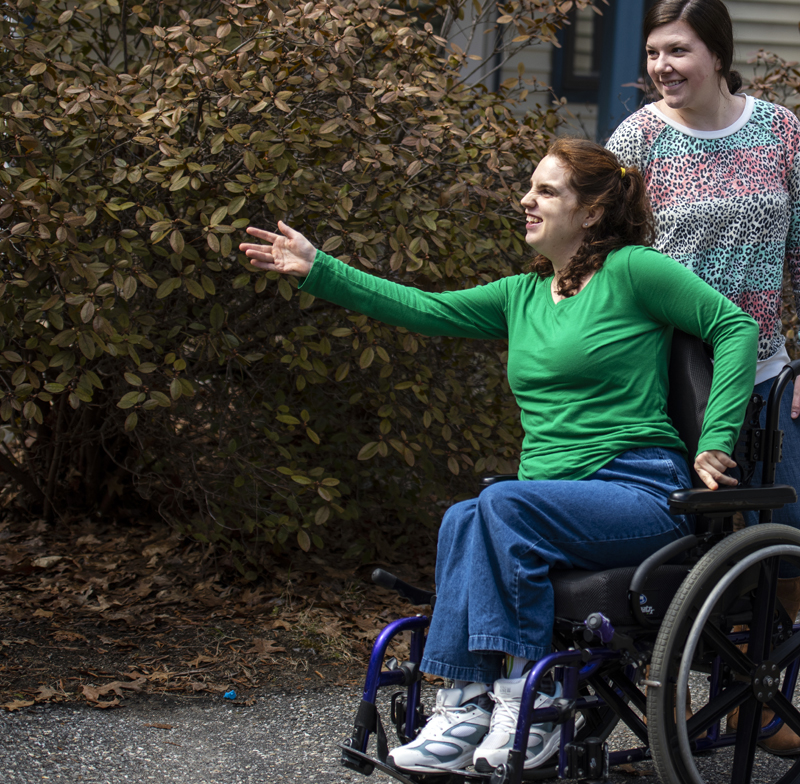 Vicki L'Heureux (left) reaches out for a hug at a Mobius Inc. residence in Newcastle on March 31. Physical distancing is an emotionally difficult issue for both residents and staff. (Bisi Cameron Yee photo)