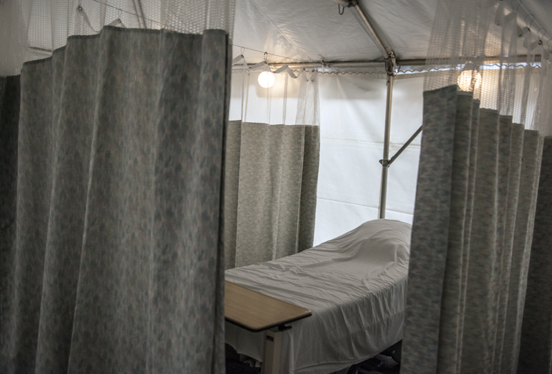 Curtains surround a bed in the new triage tent at LincolnHealth's Miles Campus in Damariscotta on Monday, March 30. LincolnHealth is preparing for an influx of patients as the number of coronavirus cases in the state continues to climb. (Bisi Cameron Yee photo)