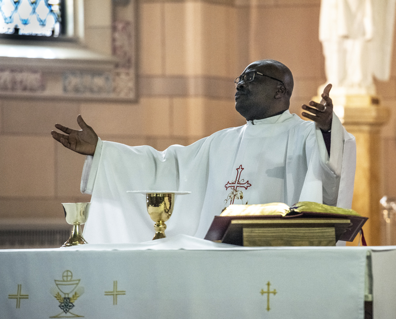 Father Patrick Agbodi, of Newcastle, leads the Easter Mass at St. John the Baptist Catholic Church in Brunswick on Sunday, April 12. Agbodi had planned to lead the Easter service at St. Patrick's in Newcastle, but heavy snow and power outages forced the parish to move the service to St. John's. (Bisi Cameron Yee photo)