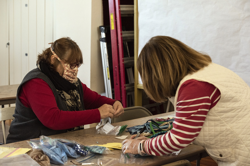Cally Bartholomae (left) and Patty Stevens sort and pack face masks at The First Baptist Church of Nobleboro on Monday, April 20. The masks went to the Nobleboro Post Office and Nobleboro Village Store for free distribution in the community. (Bisi Cameron Yee photo)