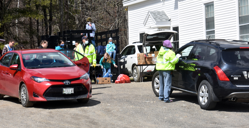 Somerville firefighters distribute food at a pop-up pantry Thursday, April 16. (Alexander Violo photo)