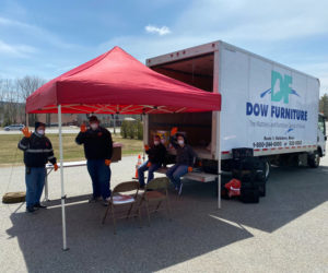 Volunteers staff a drive-thru food pantry at the Waldoboro municipal building Tuesday, April 21. Organizers plan to hold the events weekly throughout the state of emergency. (Photo courtesy Julie Keizer)