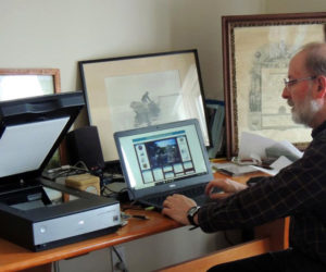 Collections manager Chuck Rand works on creating searchable computer records for the Old Bristol Historical Society's Digital Images Archive. Records that have been scanned into the archive will be available online through a link from the society's website.