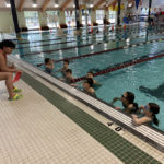 Students Take Swim Lessons for Physical Education Class