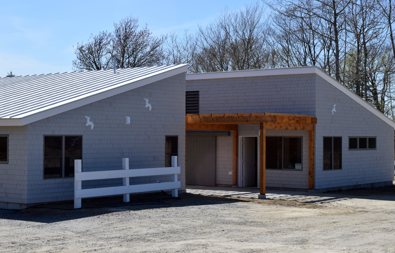 A red cedar pergola and flying sea gulls adorn the front entrance of the new Pemaquid Beach Pavilion. Construction on the pavilion wrapped Friday, May 15.  (Evan Houk photo)