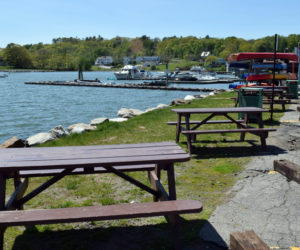 Picnic tables are available for outdoor dining along the Damariscotta waterfront. The town of Damariscotta provided the picnic tables in response to a request from downtown business owners and is considering their request for an open-air market. (Evan Houk photo)