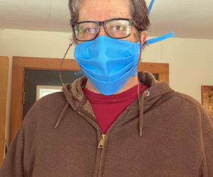 "William ""Zev"" Keisch, of Damariscotta, wears one of the hand-sewn, medical-grade face masks he and a team of volunteers are making and distributing to essential workers in Lincoln County. (Photo courtesy Zev Keisch)"