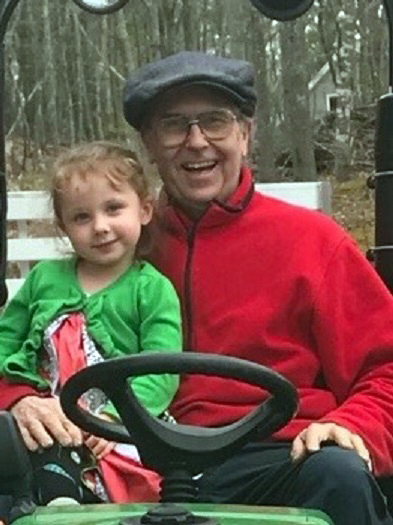 John Underwood with his granddaughter, Amira. Underwood died April 9 while assisting at an emergency scene near his home on River Road in Edgecomb.
