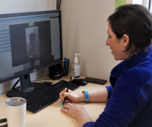 Dr. Melissa Keeport, a physician with Lincoln Medical Partners, speaks to a co-worker during a telehealth test run April 27. (Photo courtesy John Martins)