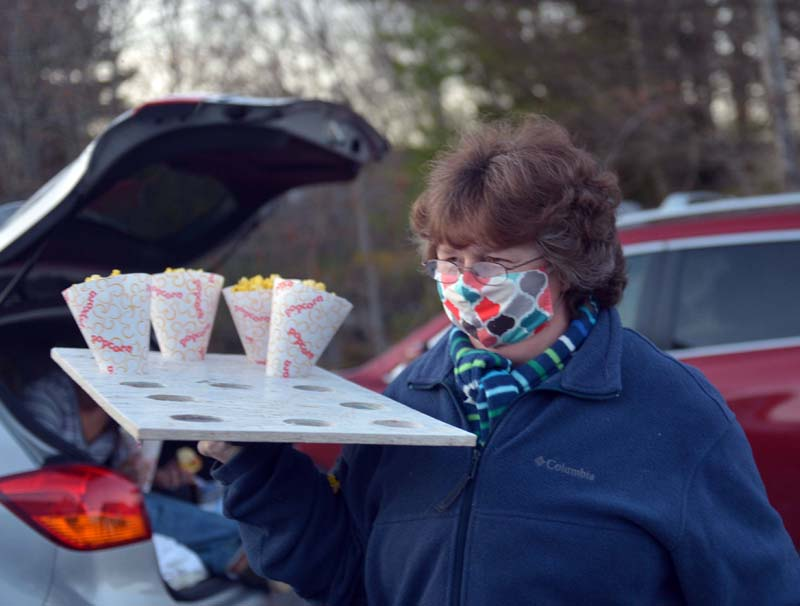 "Doreen ""Pooh"" Moody delivers free popcorn at a makeshift drive-in theater in Nobleboro. (Paula Roberts photo)"