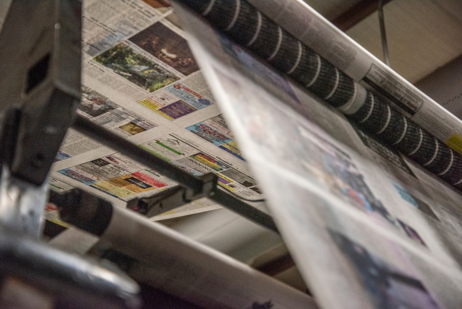 The Lincoln County News works its way through the press in Newcastle on May 6. (Bisi Cameron Yee photo)