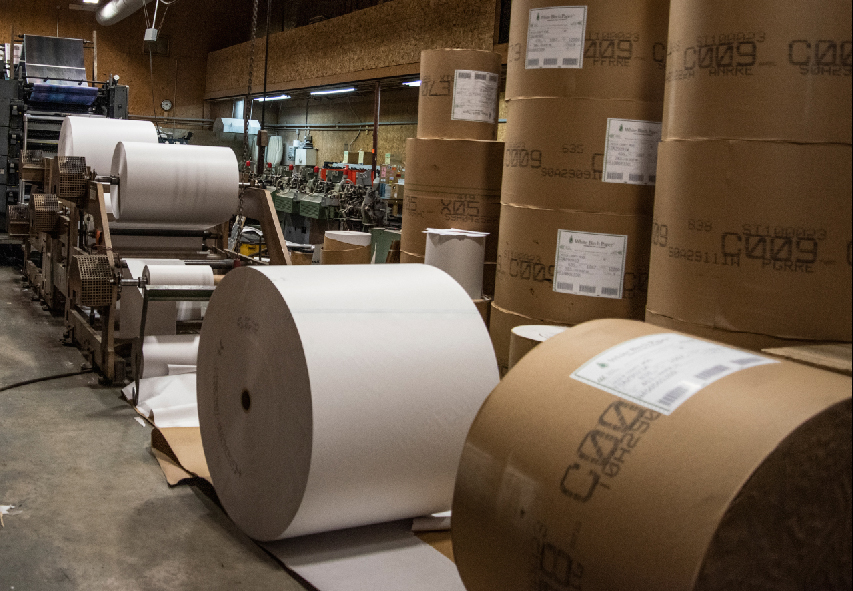 Large rolls of paper feed the press at The Lincoln County News in Newcastle on March 16. Everyone in the print shop pitches in when the presses run to ensure the print edition reaches newstands Wednesday afternoon. (Bisi Cameron Yee photo)